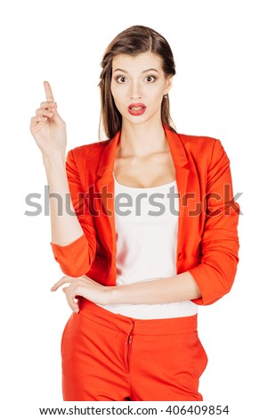 portrait of young business woman in red suit pointing up and showing copy space. isolated on white background. business and lifestyle concept - stock photo