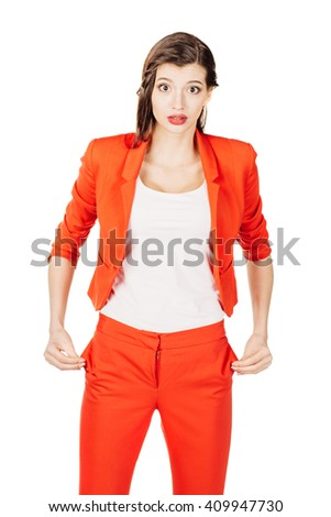 portrait of young business woman in red suit showing her no money by turning out the pockets. isolated on white background. business and lifestyle concept - stock photo