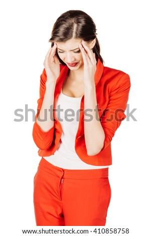 portrait of young business woman in red suit with a headache holding head. isolated on white background. business and lifestyle concept - stock photo