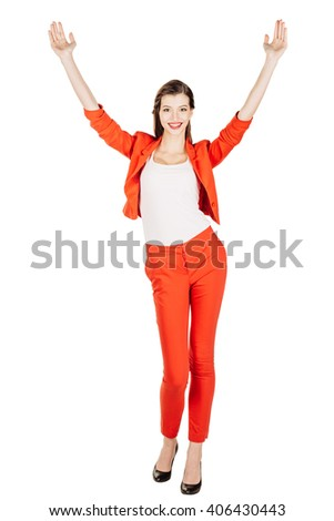 portrait of young business woman in red suit with arms up. isolated on white background. business and lifestyle concept