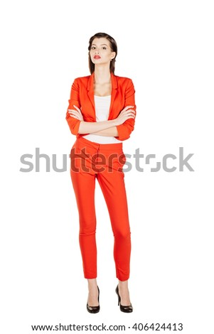 portrait of young business woman in red suit with crossed arms. isolated on white background. business and lifestyle concept