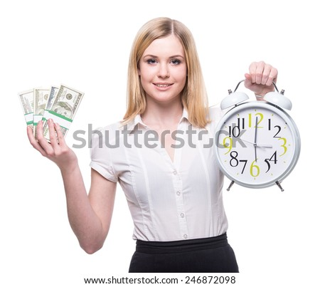 Portrait of young business woman is holding in hands clock and money, isolated on white background, discipline and punctual concept. - stock photo