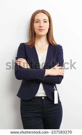 Portrait of young business woman over white background - stock photo