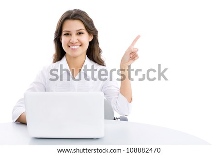 Portrait of young business woman pointing at corner - Copyspace - stock photo