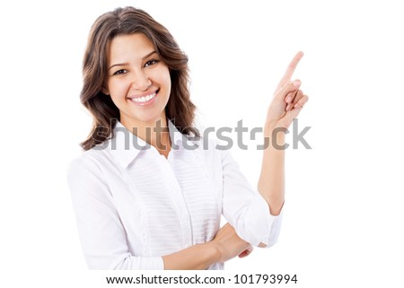 Portrait of young business woman pointing at white background
