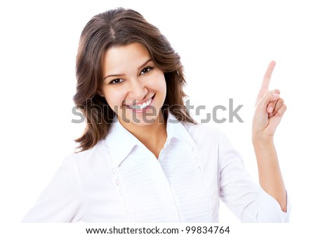 Portrait of young business woman pointing at white background - stock photo