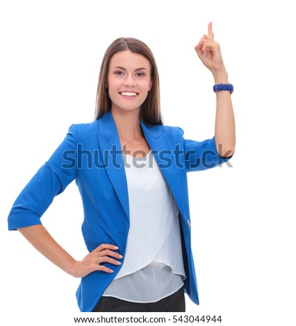 Portrait of young business woman pointing on white background