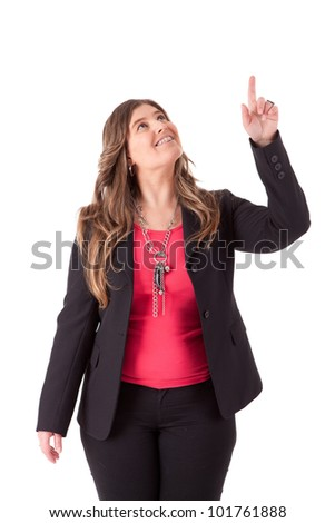 Portrait of young business woman pointing up - stock photo