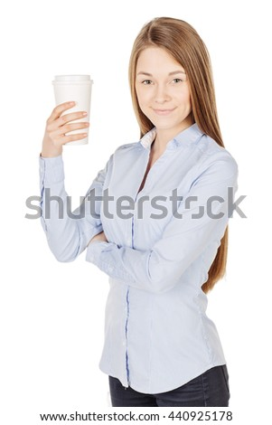 Portrait of young business woman smiling and looking into the camera, holding paper cup of coffee in her hand. image on a wight studio background.