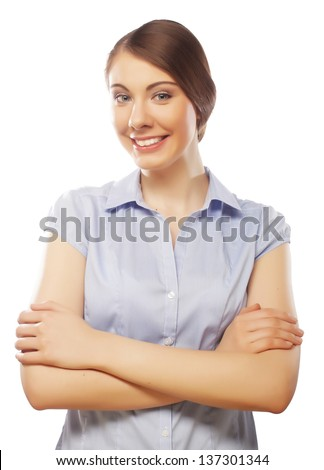 Portrait of young business woman smiling casually over white background
