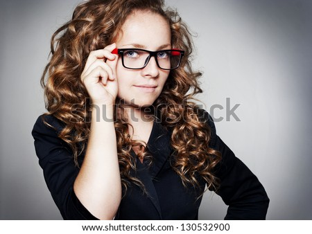 Portrait of young business woman wearing glasses - stock photo