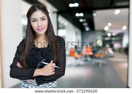 Portrait of young business woman with arms crossed. - stock photo
