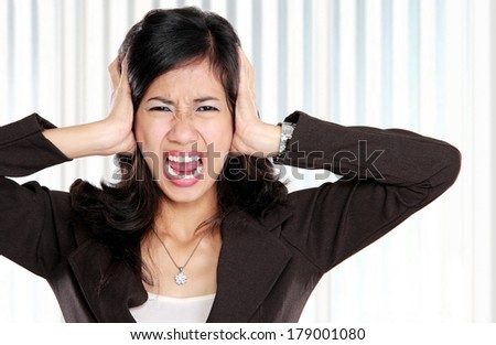 portrait of young business woman with stressed and depressed  due to overwork in the office - stock photo
