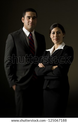 Portrait of young businessman and businesswoman - stock photo