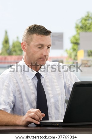 Portrait of young businessman  getting busy with her laptop