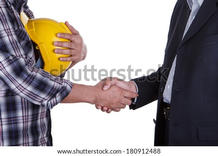 Portrait of young businessman handshake with the architect. - stock photo