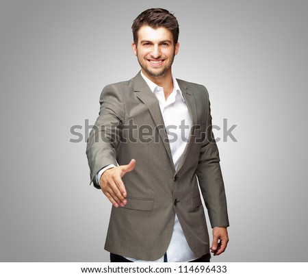 Portrait Of  Young Businessman In A Suit Holds Out His Hand For A Handshake