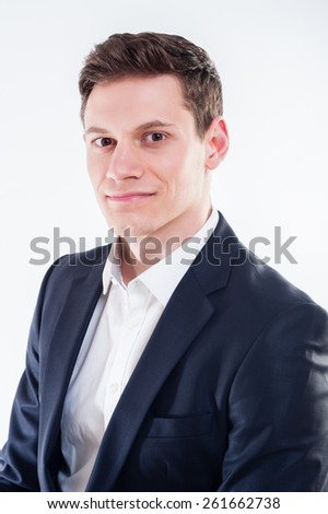 Portrait of young businessman in black suit on white background - stock photo
