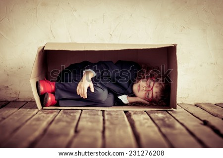 Portrait of young businessman in cardboard box. Think outside the box. Copy space for your text - stock photo