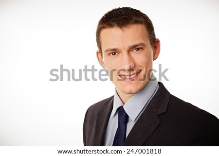 Portrait of young businessman in suit, left you can write some text