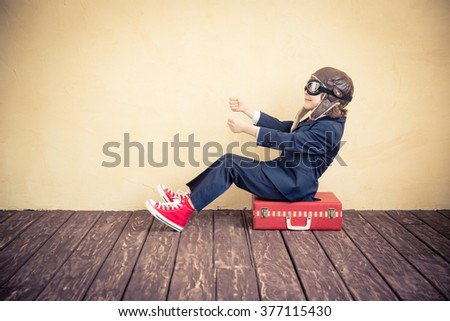 Portrait of young businessman kid in office. Success, creative and innovation concept - stock photo