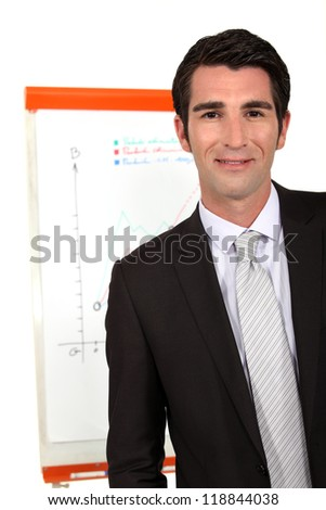 portrait of young businessman making presentation during meeting - stock photo