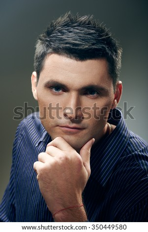 Portrait of  young businessman on gray  background