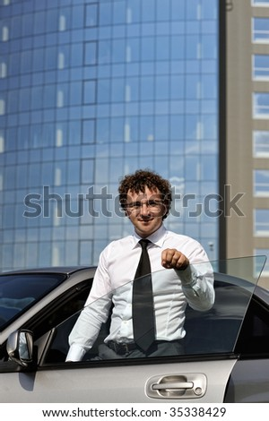 Portrait of young businessman outdoors
