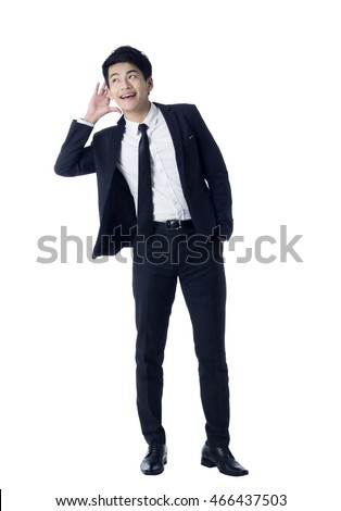 Portrait of young businessman putting hand near his ear