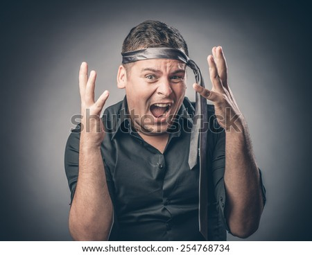 Portrait of young businessman shouting