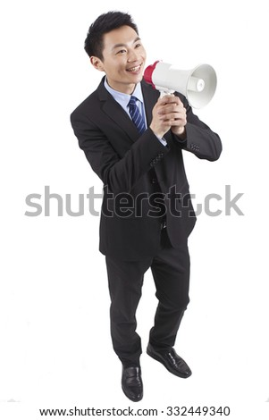 Portrait of young businessman shouting into Megaphone,close-up