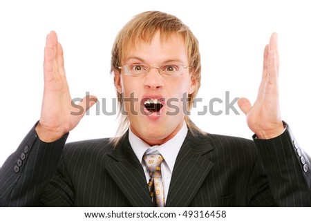 Portrait of young businessman shouting loudly with his arms widened, isolated on white background.