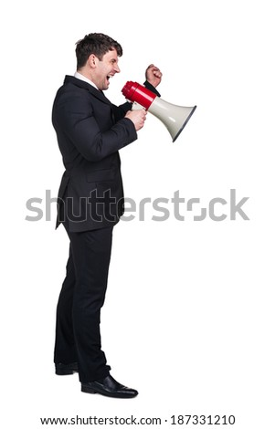Portrait of young businessman shouting using megaphone isolated on white background