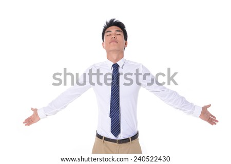 portrait of young businessman shrugging - stock photo