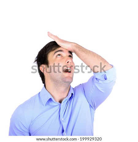 Portrait of young businessman slapping hand on head having a duh moment - stock photo