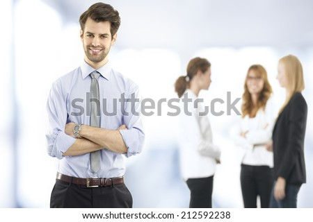 Portrait of young businessman standing at office. Small business.