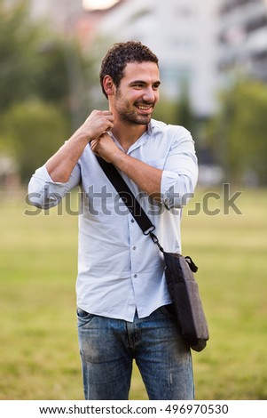 Portrait of young businessman standing at the park.Portrait of young businessman