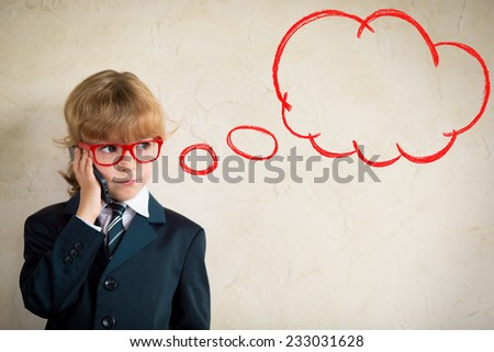 Portrait of young businessman talking by smartphone in office. Copy space for your text - stock photo