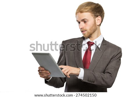 portrait of young businessman using tablet isolated on white background