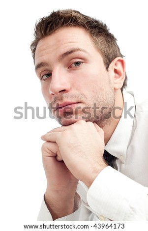 Portrait of young businessman who is upset and sad. Close up isolated on white