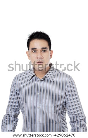 Portrait of young businessman with angry expression, isolated on white background
