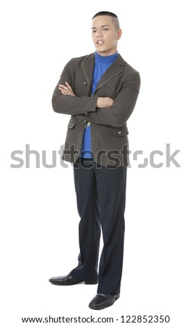 Portrait of young businessman with arm crossed against white background