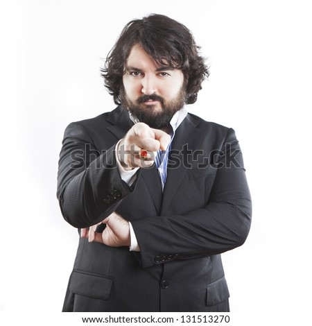 portrait of young businessman with beard pointing at you