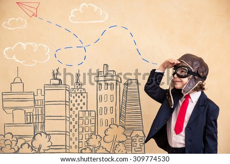 Portrait of young businessman with drawn airplane over city. Success, creative and start up concept - stock photo