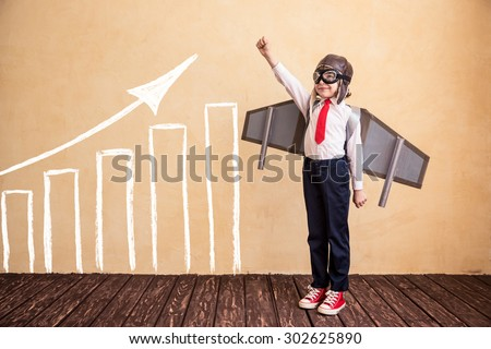 Portrait of young businessman with toy paper wings. Success, creative and start up concept. Copy space for your text - stock photo