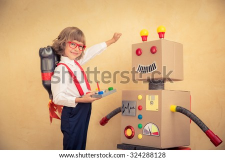 Portrait of young businessman with toy robot in modern loft office. Success, creative and innovation technology concept. Copy space for your text - stock photo