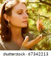 Portrait of young  businesswoman in a natural environment - stock photo