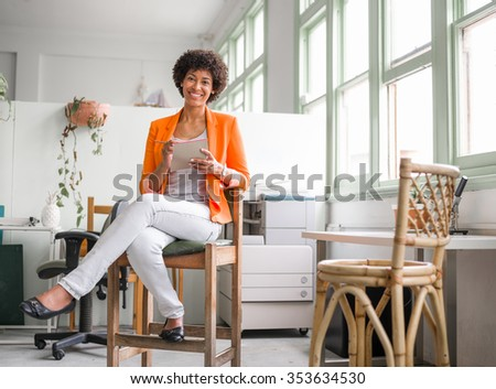 Portrait of young businesswoman in office - stock photo