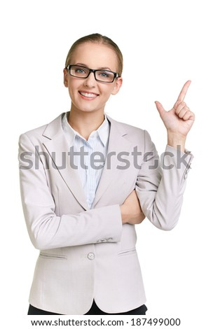 Portrait of young businesswoman keeping her forefinger up