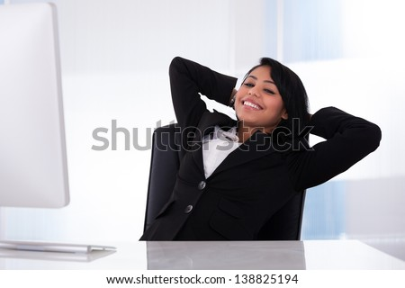 Portrait Of Young Businesswoman Relaxing In The Office - stock photo